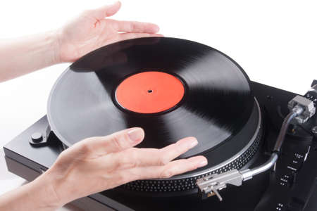 Womans Hands placing LP on turntable photo