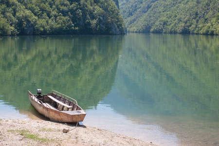 Old Rowboat At The River photo