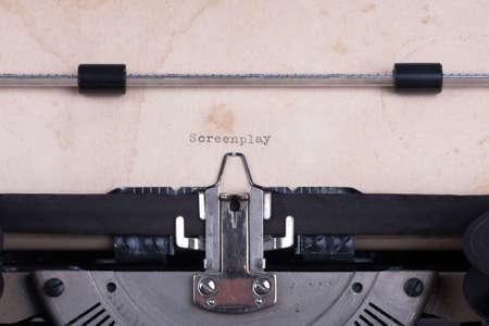screenplay: word Screenplay typed by vintage typewriter