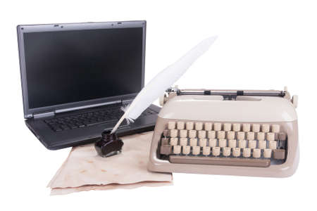 black laptop, old ypewriter and Feather pen into the inkwell isolated on white background photo