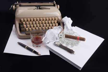 Old german type writer with paper, cigare, vintage watch, fountain pen and glass of whiskey Stock Photo