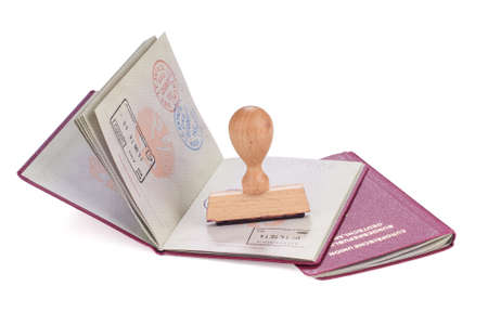 foreigner: Stamp and passports of Germany over white background