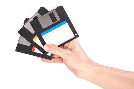 megabyte: Female hand holding floppy disks on white background