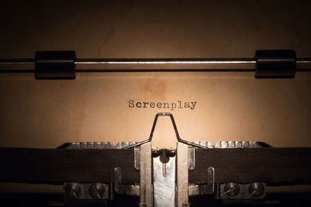 screenplay: Screenplay message printed on old typing machine