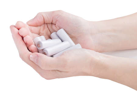 armful: female hands are kept in an armful batteries over white