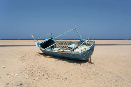 beached: Old beached fishing Boat on the coast of Red Sea