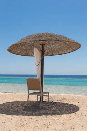 red sea: beach umbrella with chair on beach at red sea
