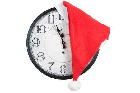 midnight: Vintage Clock around midnight with christmas santa hat Stock Photo