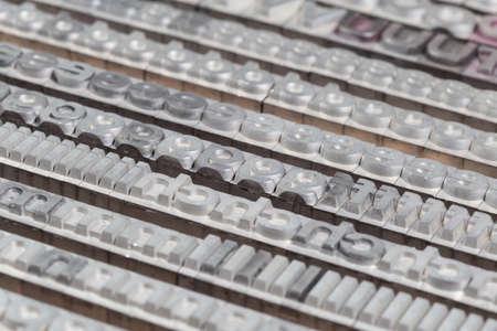 letterpress letters: Arrangement of letterpress lead letters in row