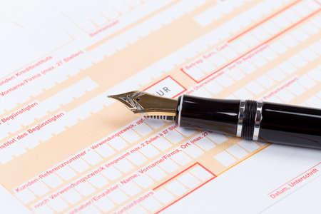 deposit slip: Fountain Pen on empty Remittance slip macro