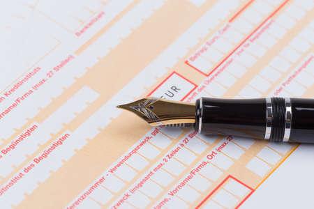 deposit slip: Old Fountain Pen on empty Remittance slip macro