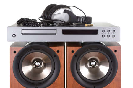cd player: high loudspeaker tower with cd player headphone over white background