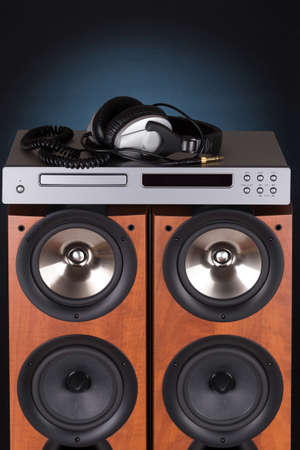 cd player: high loudspeaker tower with cd player headphone over black background Stock Photo