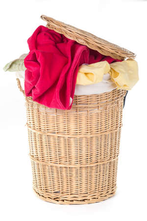 basket: Laundry Basket with colorful laundry over white