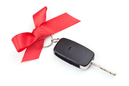 lock: Car keys with red bow over white background