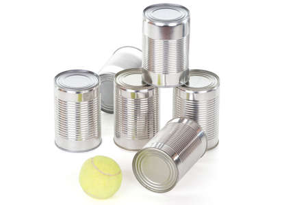 knockdown: tin can pyramid with tennis ball over white