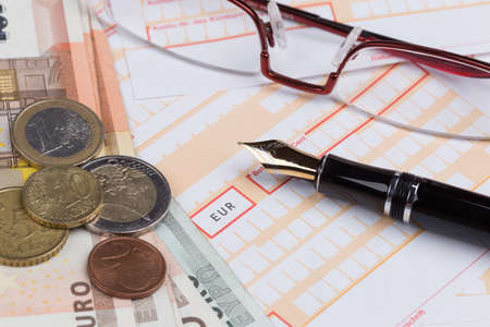 deposit slip: Fountain Pen on empty Remittance slip with coins Stock Photo