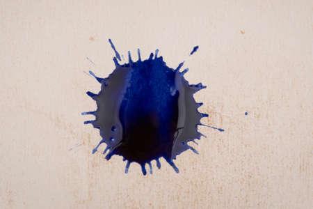 ink blots: blue ink blots on old paper
