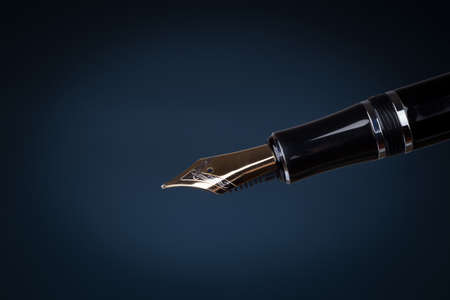 fountain pen: old fountain pen over black background