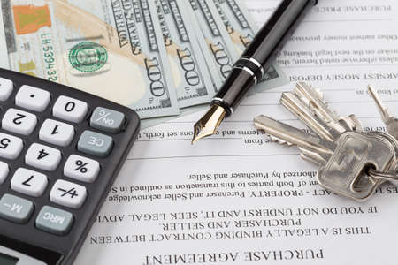 financial security: purchase contract with the keys to the apartment Stock Photo