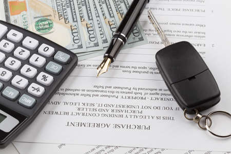 financial services: purchase contract with the car keys and money