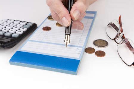 receipt: Receipt Book Fountain Pen, glasses and calculator