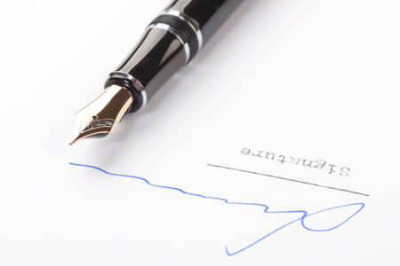 pen and paper: Signature on white paper with old fountain pen Stock Photo