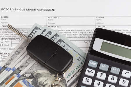 motor vehicle: Lease motor vehicle Document Agreement with car key anc calculator Stock Photo