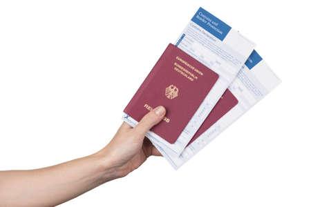 declaration: female hand holding german travel passports with the customs declaration