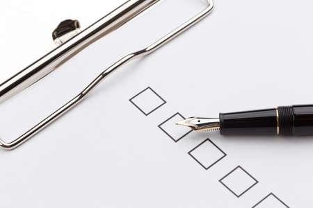 checkbox: fountain pen and checkbox on the clip board over white