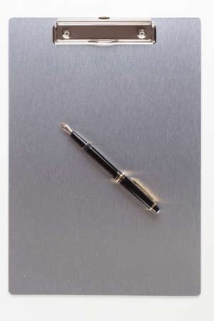 metall: metall clipboard and fountain pen over white