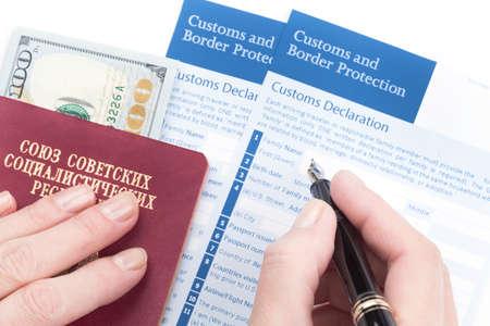 declaration: female hand  fills customs declaration travel passport of soviet union