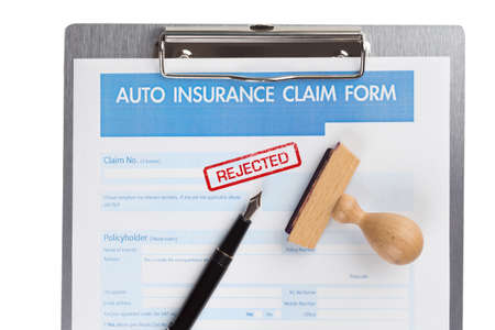 rejected: auto insurance claim form with stamp rejected