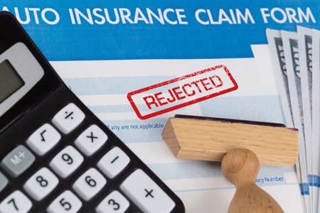 stamp: auto insurance claim form with dollar and calculator
