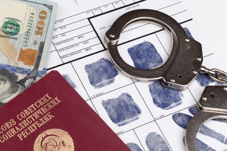 fingerprinting: Fingerprint card with russian travel passport of Soviet Union and handcuffs