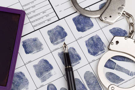 fingermark: Fingerprint card with russian travel passport and handcuffs Stock Photo