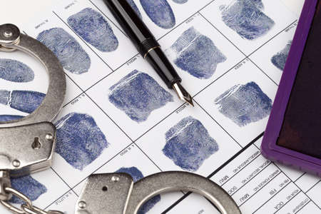 friction ridges: Fingerprint card with handcuffs and Stamp pad