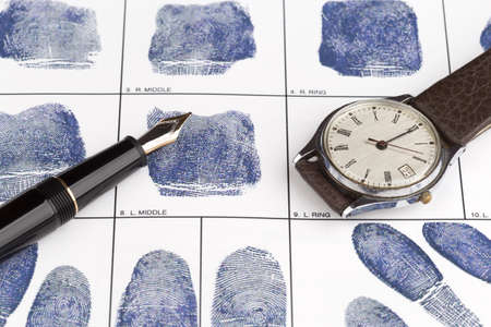 fingerprinting: Fingerprint card with fountain pen and old watch