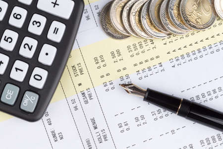 account statements: sales receipt from the store with euro coins and calculator