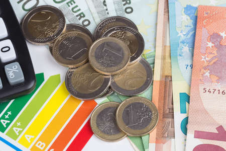 consuming: Energy efficiency rating scale with euro money Stock Photo