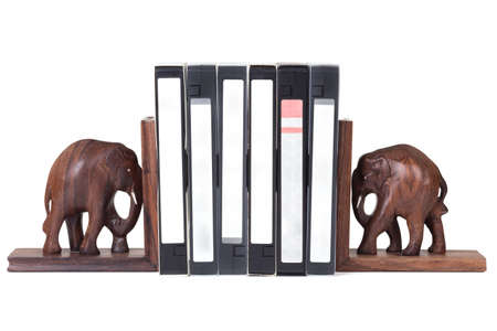 elephant bookend with video cassette over white