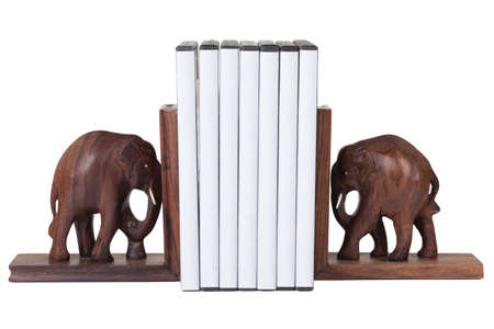 elephant bookend with dvd box over white