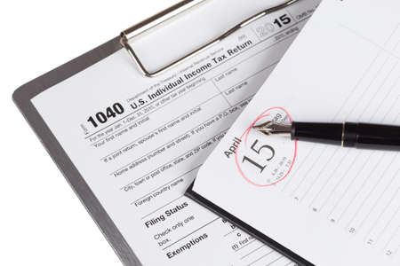 income tax: Income Tax Return Form with fountain pen