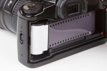 slr: Analog SLR camera with the inserted film