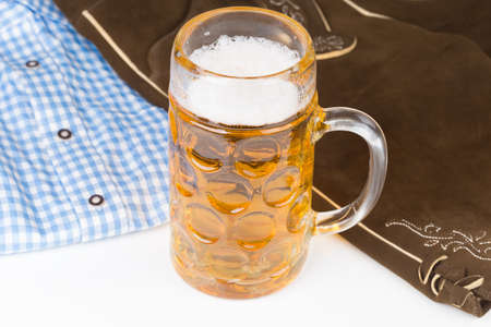 customs and celebrations: traditional Bavarian pants deerskin and a mug of beer Stock Photo