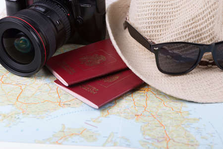 russian hat: russian passports and sunglasses with straw hat and camera Stock Photo