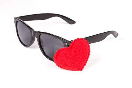 wayfarer: sunglasses wayfarer with heart symbol over white Stock Photo