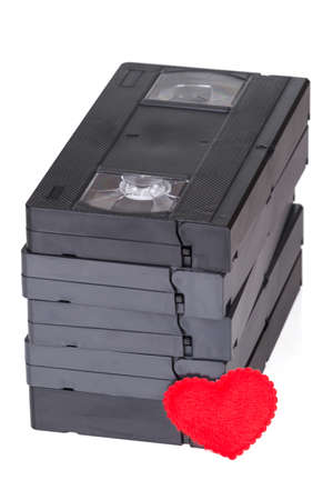 videocassette: Stack of VHS tapes with heart symbol over white