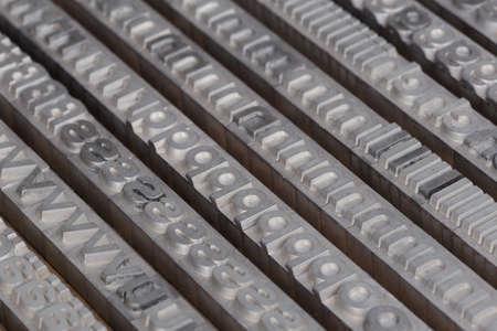 letterpress: Arrangement of letterpress lead letters in row