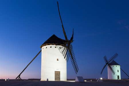 Windmill near Alcazar de San Juan at evening, Castile region, Spain, Stock Photo